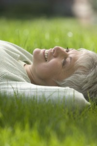 Woman Lying Down in the Grass